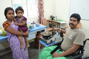 Rohit using learning to cook from his wheelchair