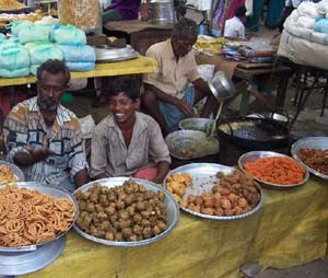 Snacks such as 'thair wadai' at the market.