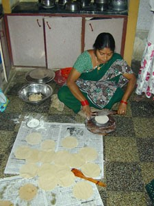 Preparing chapatis for visitors.