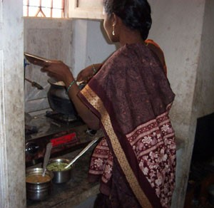 Uma prepares a meal of rice, sambhar and rasam.