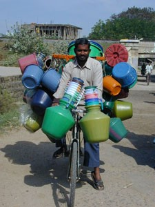Bicycle laden with pots.