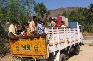 Lorry transporting people.