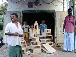 The local carpenters show off the wooden blocks they made for the Link Balwadi.