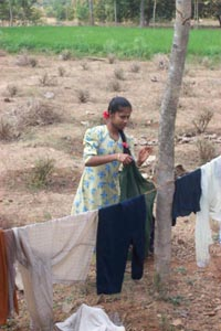 Sudha helping with family chores