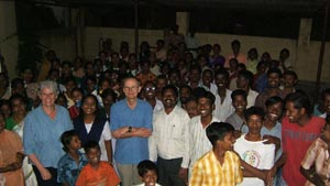 Most of the village turned out for the distribution of the first cheques.