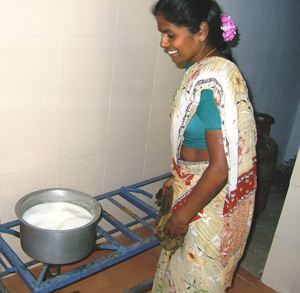 Saradha makes snacks for the elderly and the playcentre children.