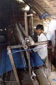 Balaji takes a day to weave 2 metres of cloth. He has recently joined a weaver's self-help group.