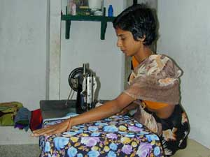 Amudha charges 12 to 15 rupees to make a sari blouse.