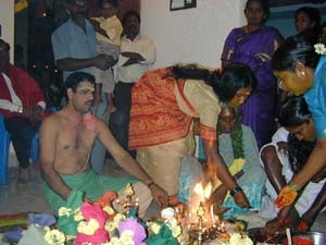 A Brahmin priest will complete the housewarming rituals at an auspicious time which is chosen by the astronomers.