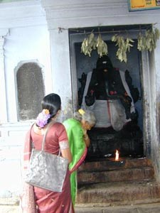 Selvi and Sorja Amma offer prayers to Lord Ganesha on the way to Tiraputi Temple in Andra Pradesh.