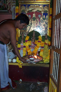 A priest makes an offering to the gods in a local temple.
