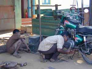 Bicycle and motor bike repairs keep mechanics busy.
