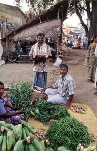 Many traders spread their wares out on the road side on market day.