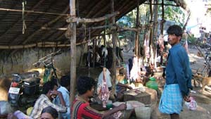 Each market day fresh goat meat is prepared and sold.