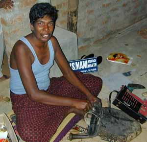 Mani has built up a successful shoe making business.