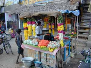 The flower seller is always busy at festival times.