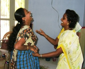 Sangeetha and Yamani throw themselves into Role Play in the home corner.