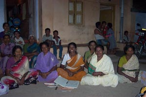 Members of the Kamatchiammanpet Women's Self Help Group attend a business meeting.