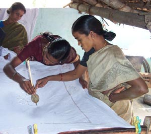 The women learn to do batik using a simple handmade tool.