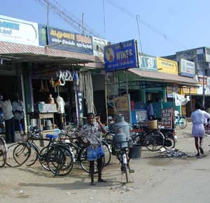 The road through K.V.Kuppam is lined with shops selling a wide range of goods.
