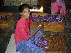 Packing matches in the Match Factory. Workers earn less than 40 rupees per day.