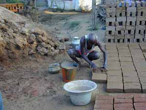 Brick making is done by hand.